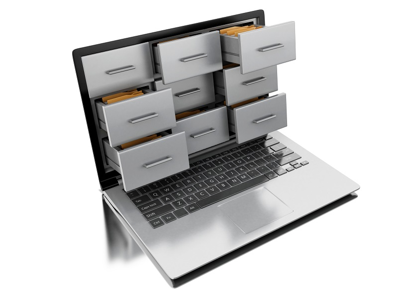 Files being cataloged digitally on a laptop.