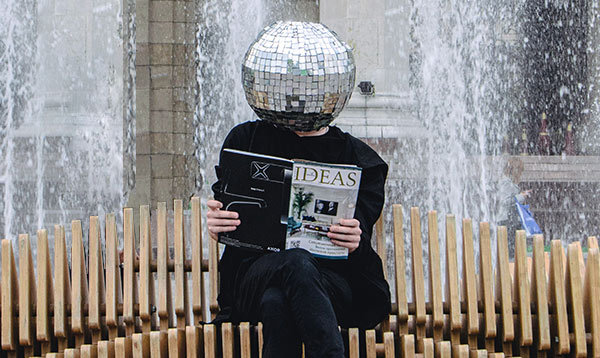 A person with a disco ball for a head.