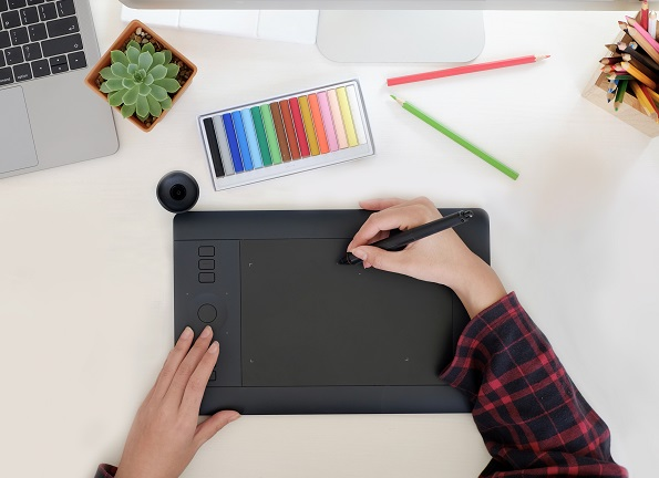 A picture of a designer drawing on a digital pad.