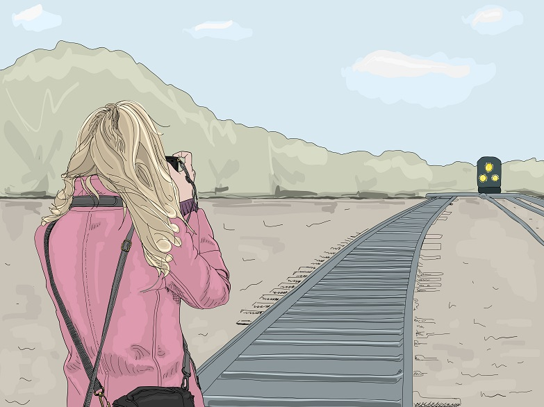 An illustration of a photographer taking a picture of a train.