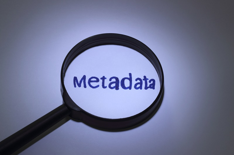 A magnifying glass amplifying the word 'metadata'.