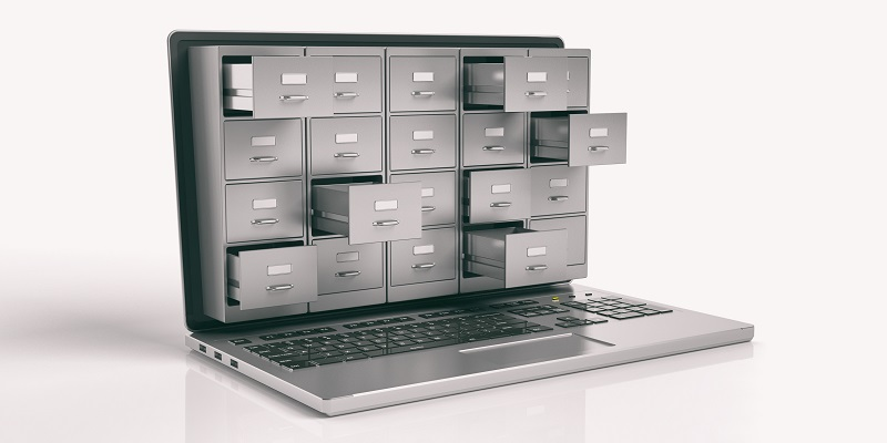 A picture of a laptop with drawers opened.
