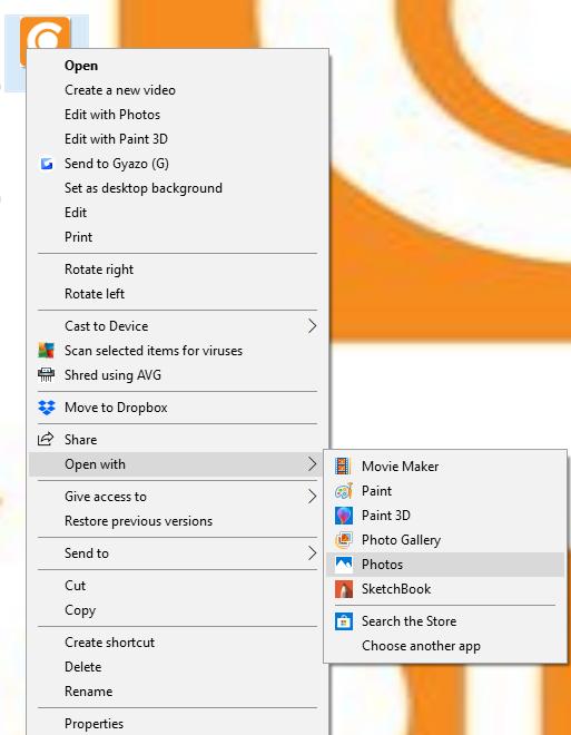 A screenshot of a user selecting Microsoft Photos.