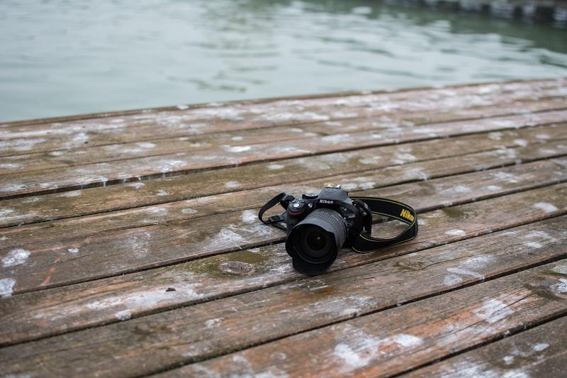 A Nikon camera on a dock.