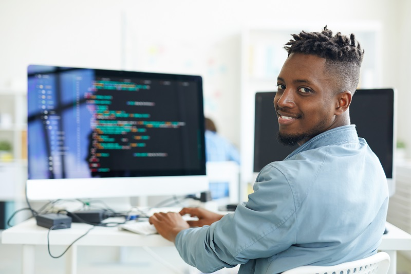 A young man works on a computer.