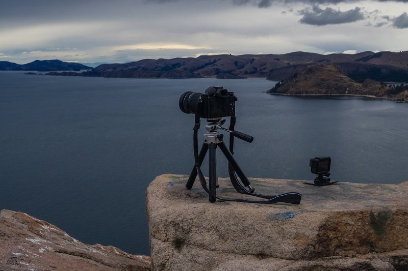 A picture of a camera photographing a lake.
