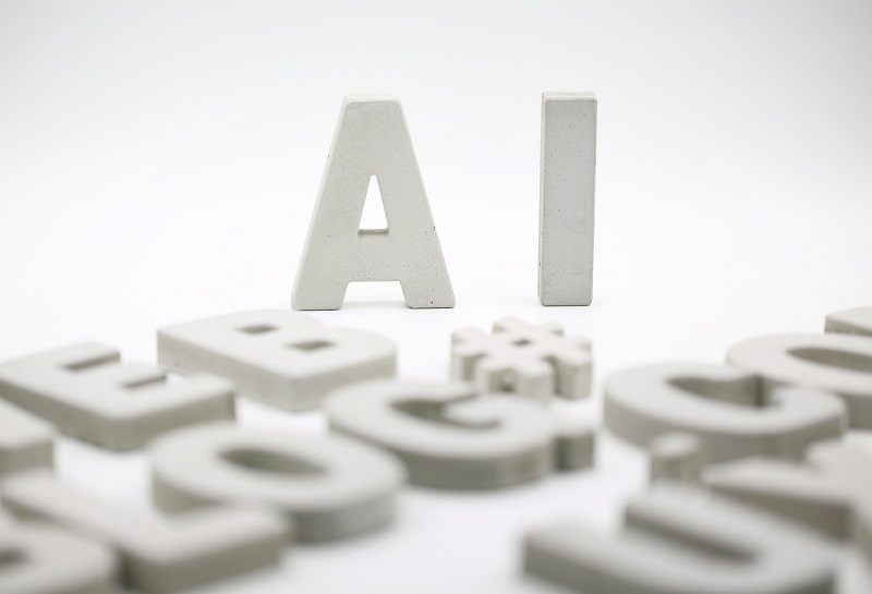 Two words standing above others that spell 'AI'.