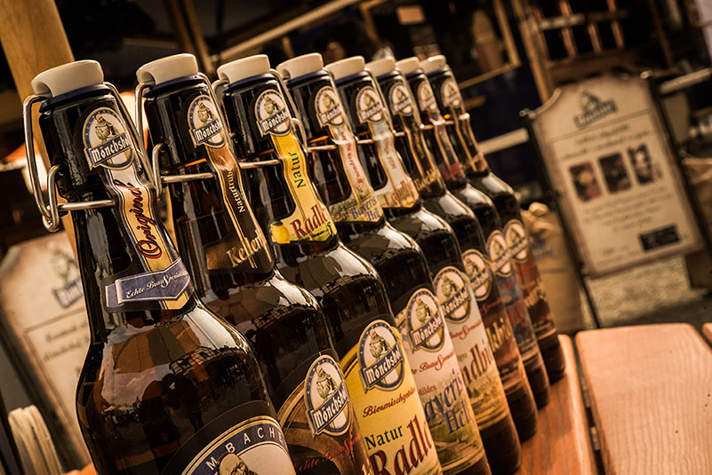 A row of bottles with Kulmbacher brewery products.