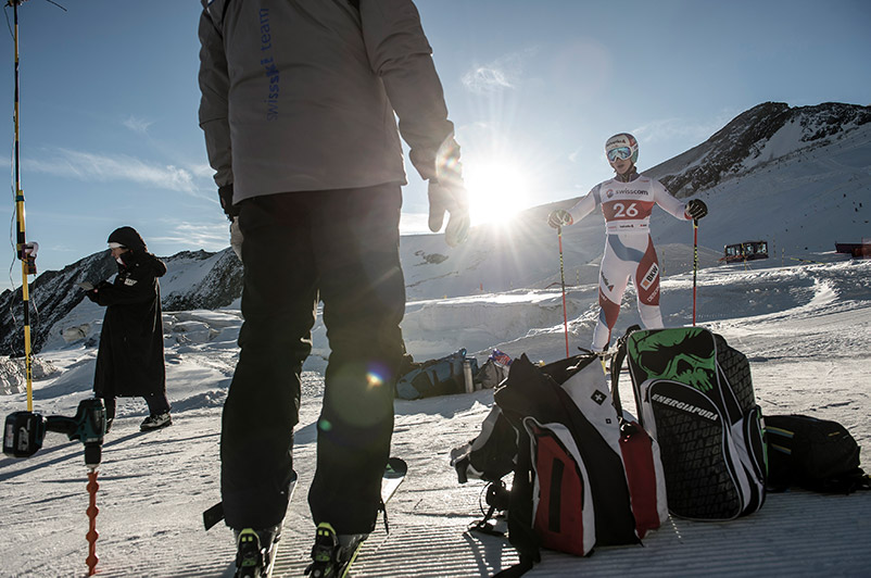 A ski athlete is standing on the slope.