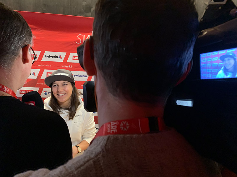 A ski athlete being interviewed.