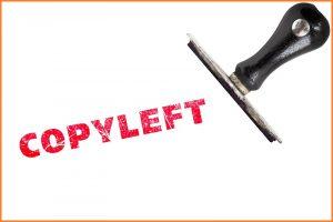 Ein schwarzer Stempel neben dem Stempelabdruck des Worts 'Copyleft' in rot.