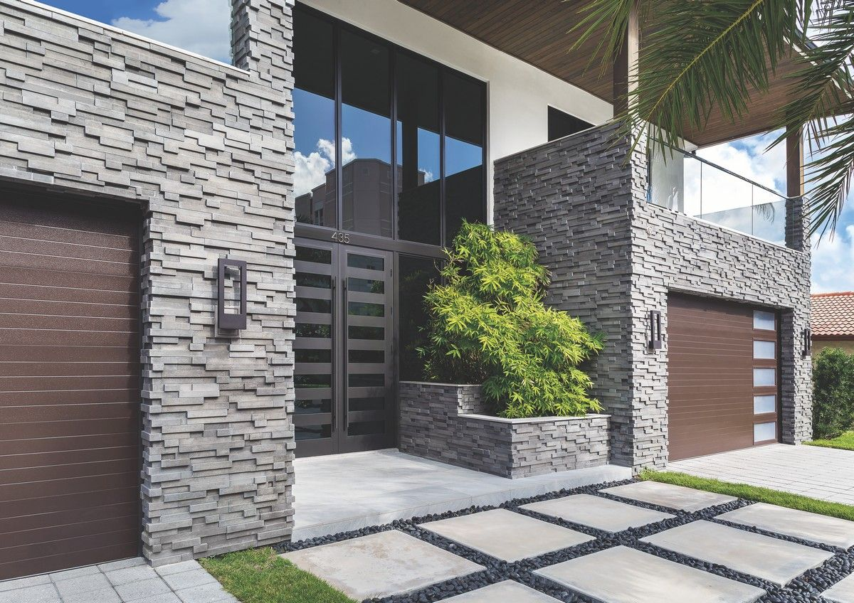 A house with a natural stone facade.