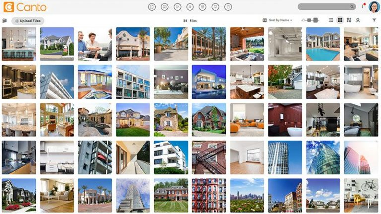 Screenshot of the main media library of the Canto DAM with previews of images showing houses and real estate.