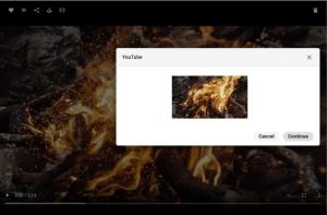 Screenshot of the interface of the Canto DAM showing a video asset with a burning fire in detailed view, overlaid by a dialog box used to share the asset on Youtube.