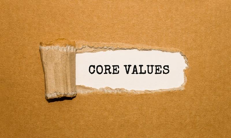 A cardboard box that has 'core values' written on it.
