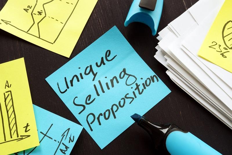 A sticky note that reads 'unique selling proposition'.