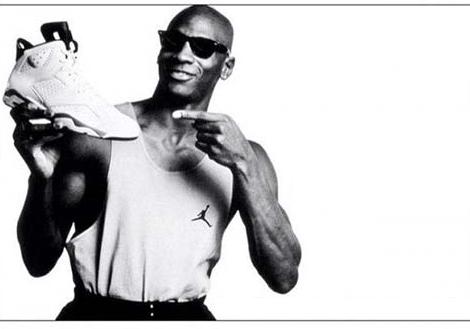 Michael Jordan holding a Nike shoe.