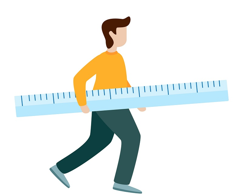 A man holding a giant ruler.