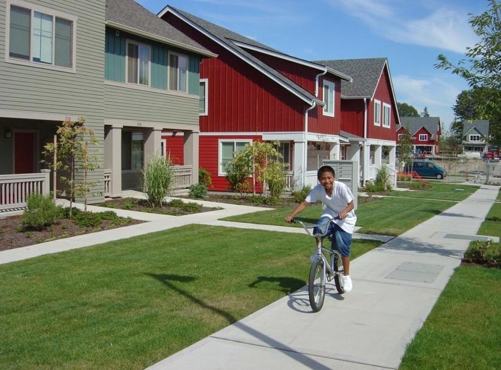 Photo of a boy on a bike.