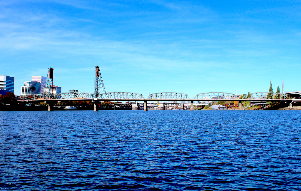 North-facing view of the Hawthorne Bridge crossing the Willamette River.