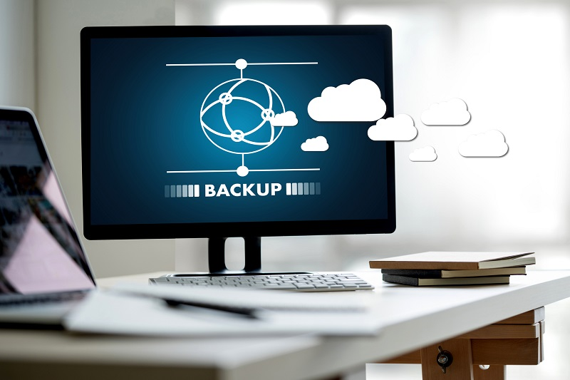 A picture of a laptop with a symbol and the word 'backup' on the screen.