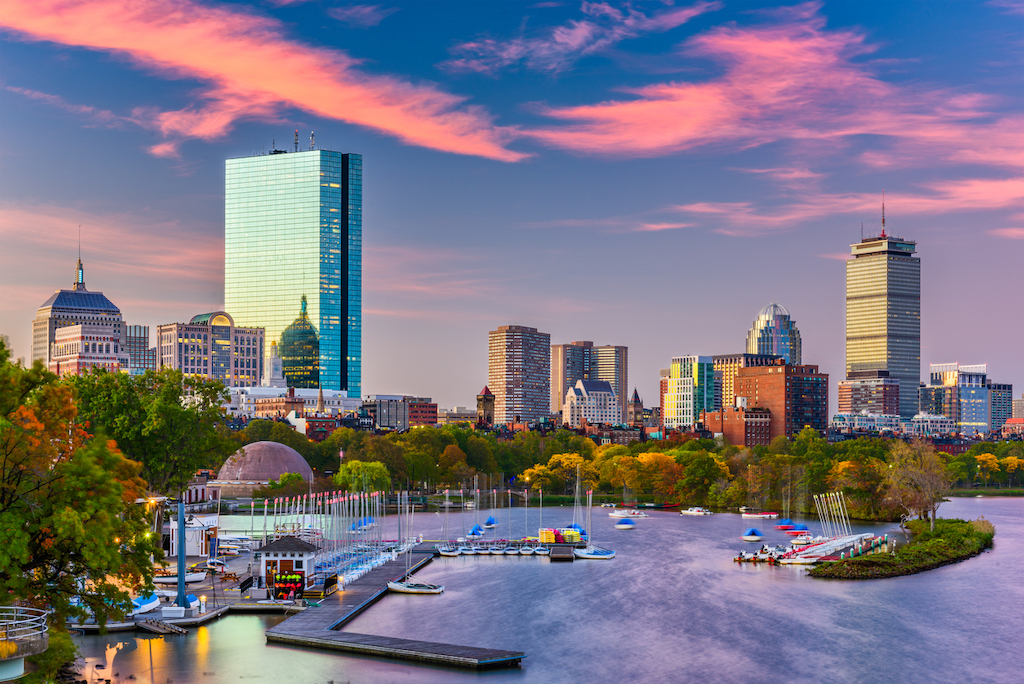 A view of Downtown Boston with harbor and skyline.