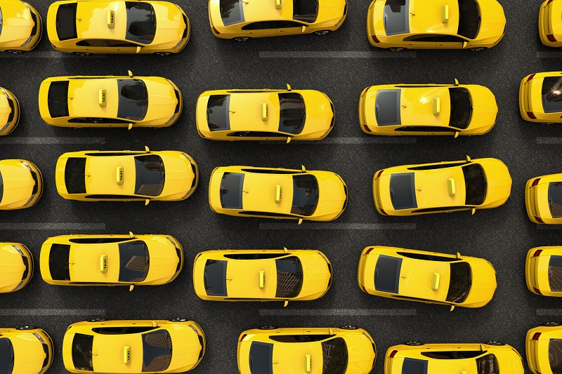 Numerous yellow taxi cabs from above.