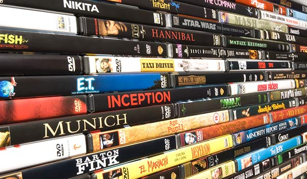 A group of stacked DVDs.