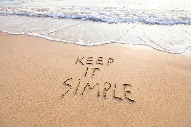 A beach with the words 'Keep it simple' written into it.