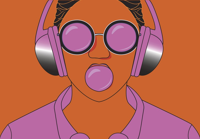 A young woman listens to purple headphones.