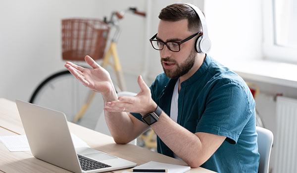 A man on a laptop.