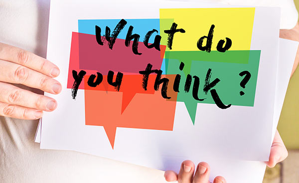 A cue card that reads 'what do you think?'
