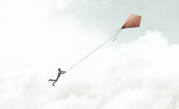 A person losing control of a kite.