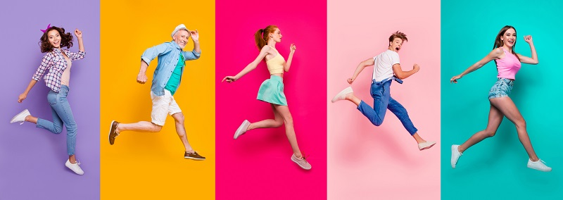 Happy people jumping on colored backgrounds.