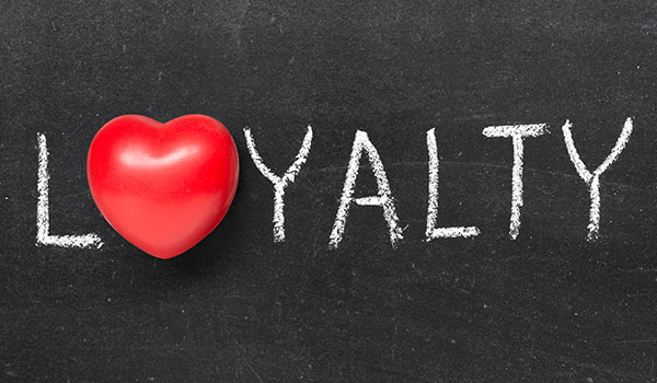 A picture of the word 'loyalty' on a chalkboard.