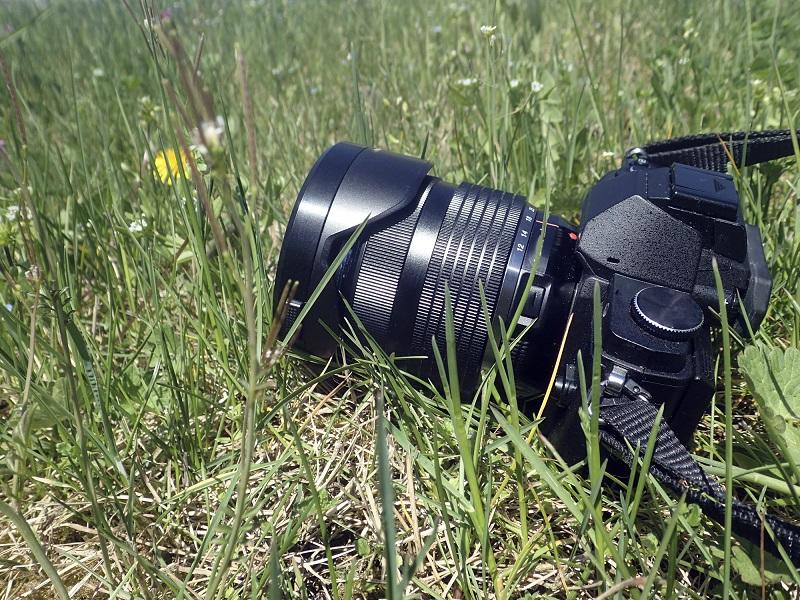 A camera in a grass field.