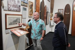 Glenn gives Canto's CEO, Jack McGannon, a tour of the SHACC gallery.
