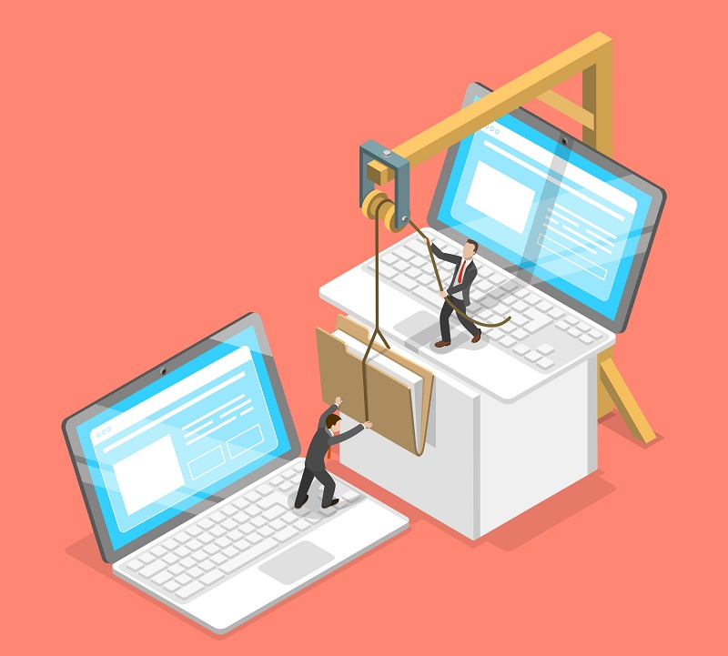 Two business workers transferring files between laptops.