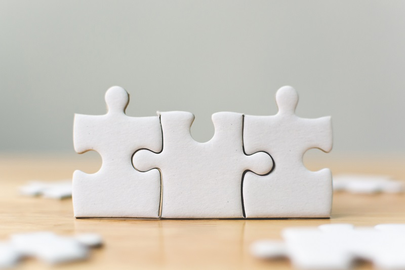 Puzzle pieces connected.