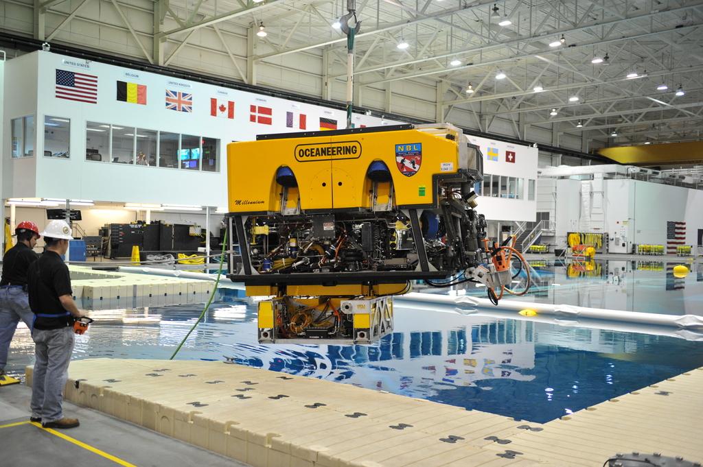 Oceaneerings technicians operating high-tech equipment.