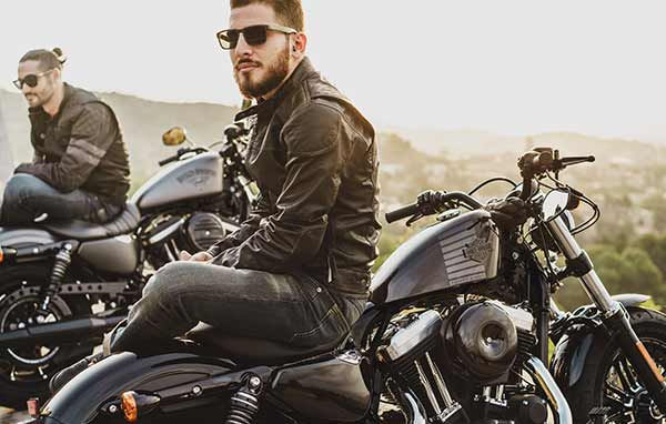 A man sitting on a motorcycle.