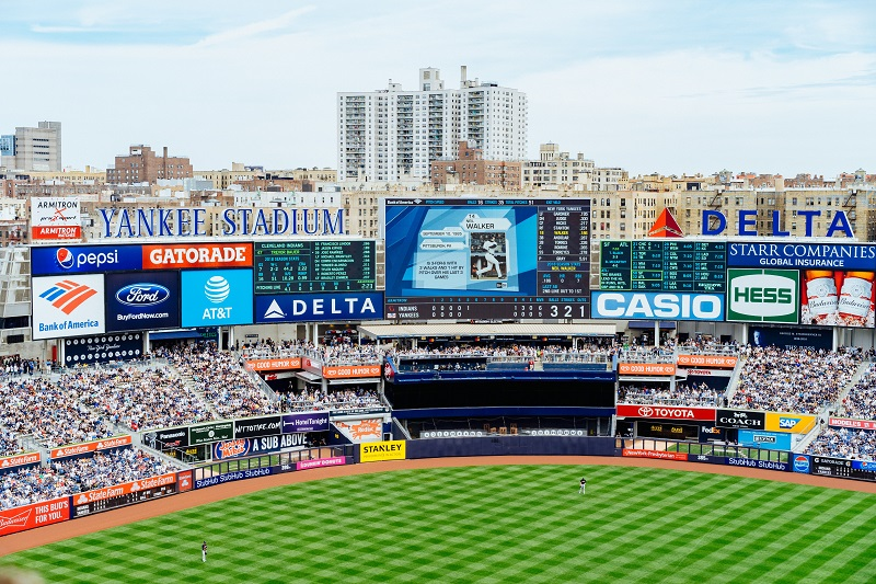 A picture of a baseball stadium with advertisement signs.