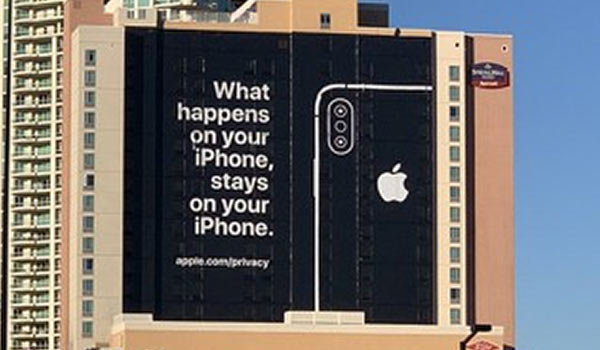 An iPhone sign on the side of a tall building complex.