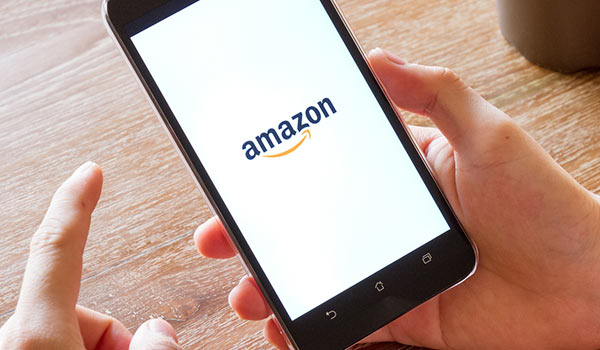 A person using Amazon on their smartphone.