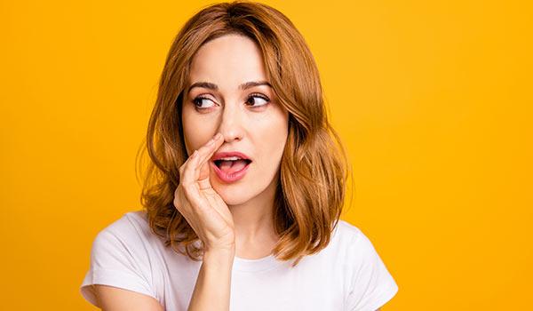 A woman telling a secret.
