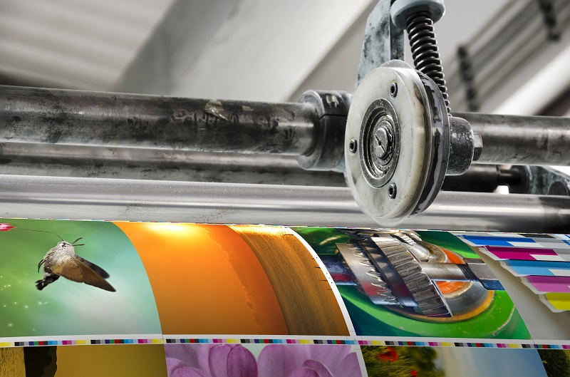 A printing machine with colorful images.