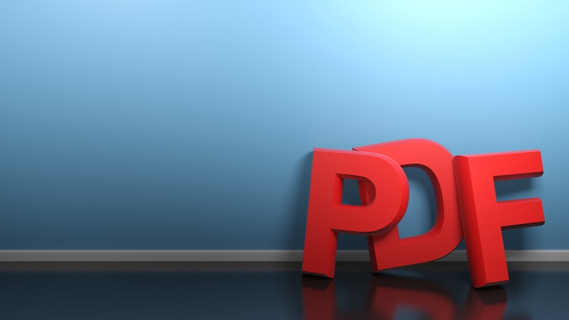 PDF letters standing next to a wall.