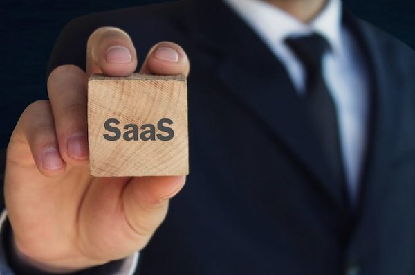 SaaS logo on a wooden cube