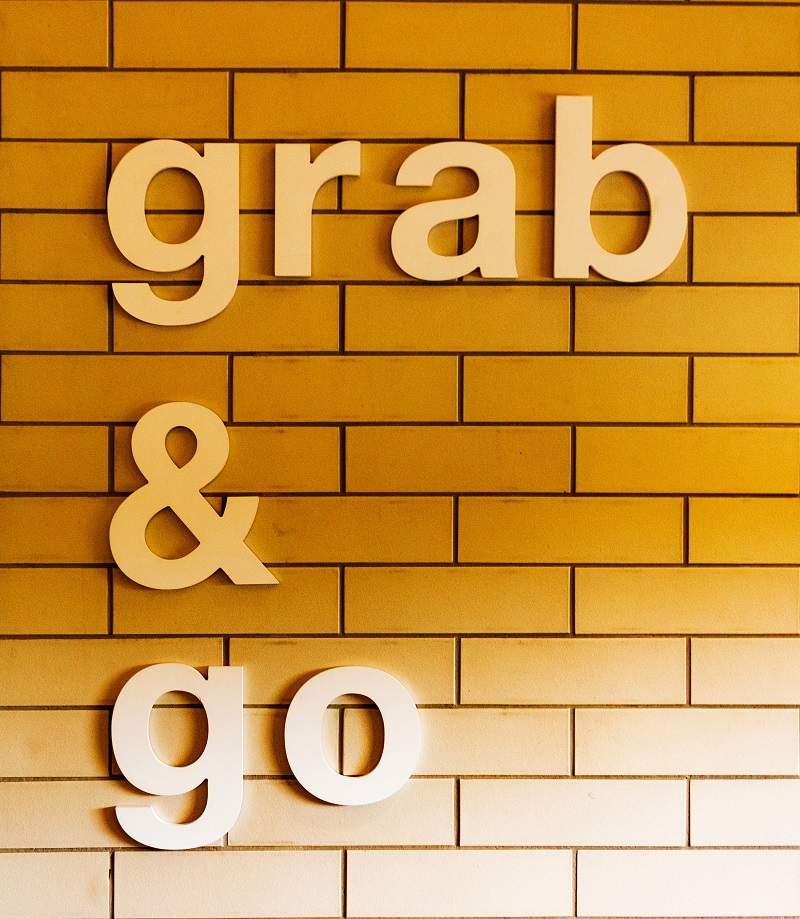 """A wall that reads, """"grab & go""""."""