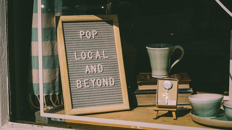 A picture of a sign in a window shop.
